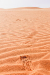 Human footprint on Mars like sand surface
