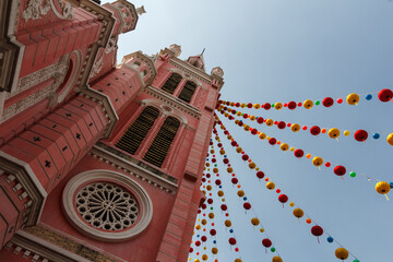 Pink church in Saigon with blue sky