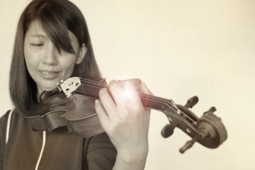 The blurry light design background of Lady playing violin with happy feeling,Lens flare effect.