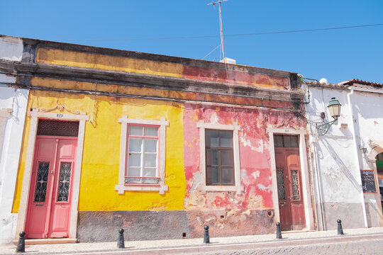A house with a dilapidated facade in the streets of Ferragudo, Algarve, Portugal