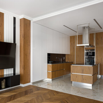 Elegant kitchen open to tv room