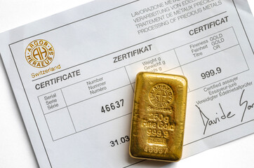 Kyiv, Ukraine – November 05, 2017: gold bar weighing 250 grams with certificate produced by the Swiss factory Argor-Heraeus, one of the world's largest processors of precious metals.