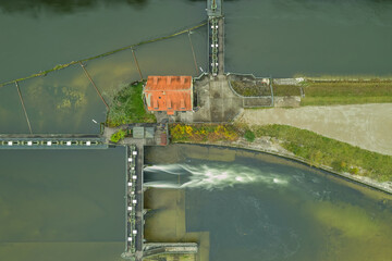 Water management via a water lock in a river in the german landscape next to munich, bavaria.