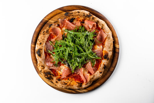 italian oven pizza with tomatoes, rucola and parsma ham