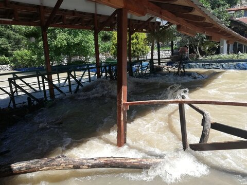 flooding damages, big damage done by a small mountain river that overflows after heavy rainfall