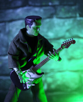 NEW YORK USA - OCT 21, 2018: MEGO Corp Frankenstein Monster action figure with a Fender Stratocaster guitar - humor regarding the Edgar Winter song named Frankenstein