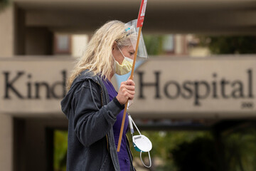 Long-term care hospital workers protest over patient and staff safety outside the facility in Westminister, California