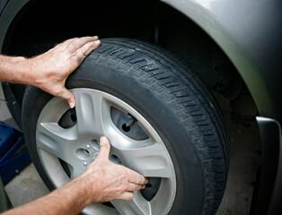 Mechanic changing a wheel, flat tire repair.