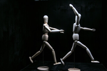 wooden mannequin with a ball