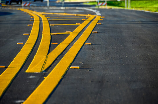 Yellow road lines receding into distance