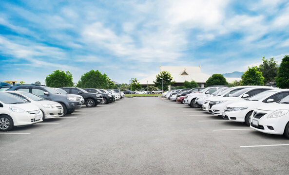 Car parking in large asphalt parking lot