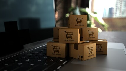 Small shipping packages on a notebook with the inscription Online Shopping