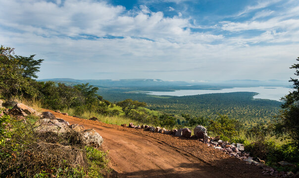 Landscape with road in the Akagera National Park, Rwanda, Africa