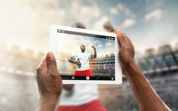 Close up hands holding tablet viewing sport, football online streaming of championship. New rules during coronavirus outbreak and countries lockdown. Concept of sport, competition, technologies.