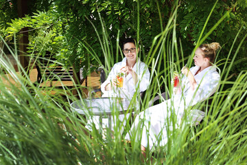 Relax on vacation. Two women are relaxing in the hotel garden.