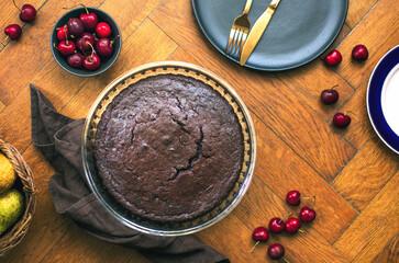 Home baked dark chocolate pie with cweet cherries