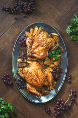Oven roasted chicken served with baked potato