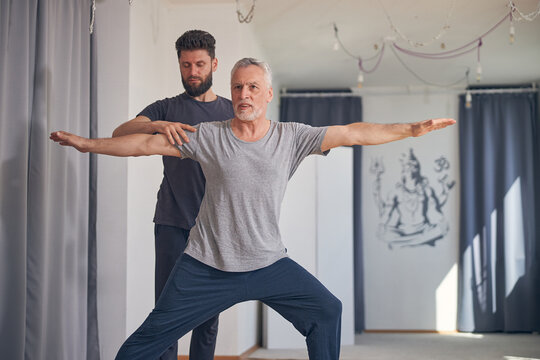 Beginner yogi doing the warrior two pose