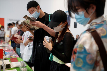 People look at books and printed art works at the abC Art Book Fair following an outbreak of the coronavirus disease (COVID-19) in Beijing