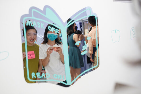 People take pictures of themselves in a mirror at the abC Art Book Fair following an outbreak of the coronavirus disease (COVID-19) in Beijing