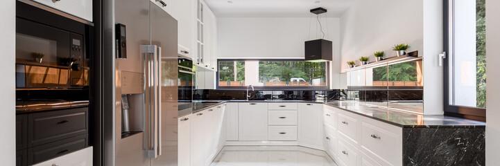 Elegant kitchen with windows, panorama