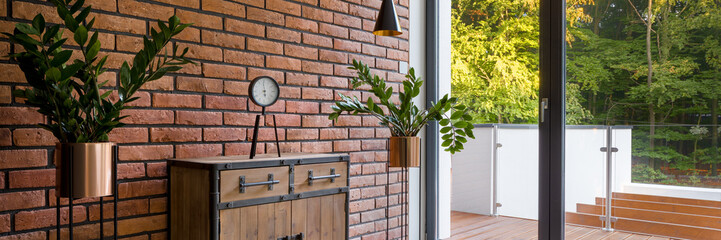 Room with brick wall and balcony, panorama