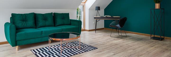 Attic living room in emerald green