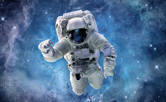 Astronaut in bright galaxy. Universe and spaceman. Outer space. Elements of this image furnished by NASA