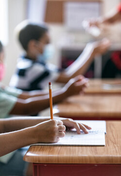 School: Focus On Girl Student Writing In Notebook