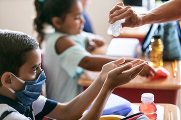 School: Teacher Gives Hand Sanitizer To Students Before Lunch
