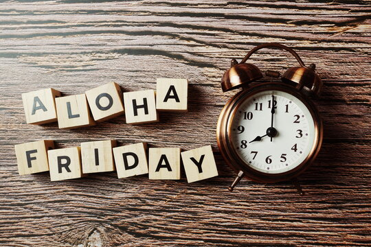 Aloha Friday alphabet letter with alarm clock on wooden background