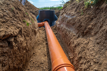 building a rainwater drainage to the collection container with the help of a plastic pipe