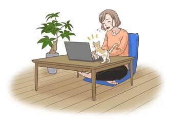 A remote working mother with some interruptions by her cat