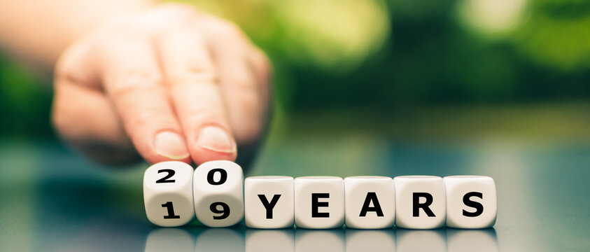 "Hand turns dice and changes the expression ""19 years"" to ""20 years""."
