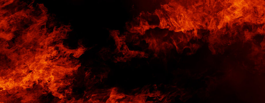 Panoramic view fire on isolated background. Perfect explosion effect for decoration and covering on black background. Concept burn flame and light texture overlays. Stock illustration