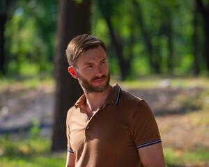 handsome bearded man looks around.