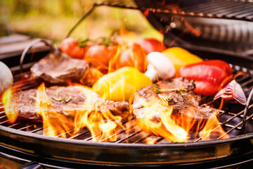 Barbecue grill with food and flame, closeup