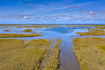 Wall Mural - Aerial view Channel Tidal Marshland Waddensea