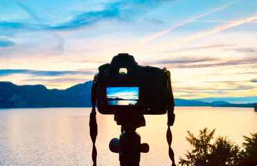 Photo camera picture. Magnificent landscape of the sunset in the mountains. Lake in sunset colors.