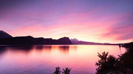 Magnificent landscape of the sunset in the mountains. Lake Lucerne in sunset colors.