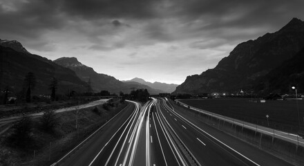 Black and white landscape graphics. Night highway. Mountains Swiss Alps. Gotthard. Switzrland