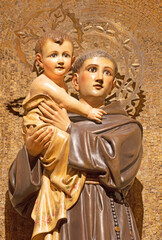 BARCELONA, SPAIN - MARCH 3, 2020: The carved polychrome statue of St. Anthony of Pauda in the church Iglesia Santa Maria de Gracia de Jesus.