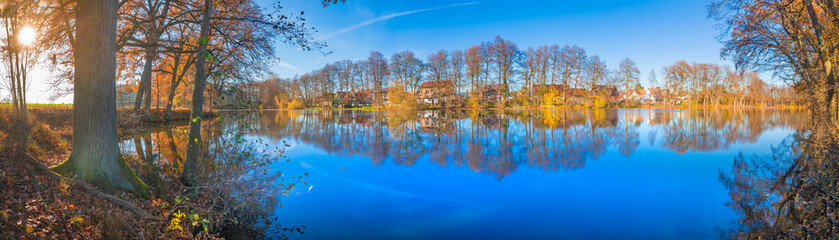 Beautiful fall scenery panorama on the lake on a sunny day