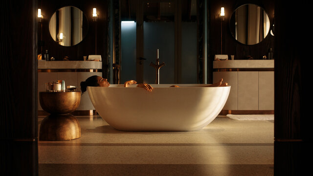 Young woman with eyes closed relaxing in bathtub at spa