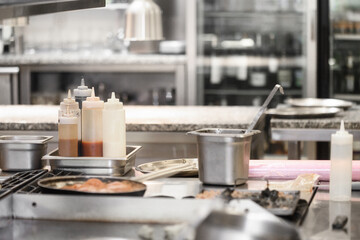Food being cooked in commercial stainless steel kitchen in restaurant. High quality photo