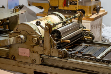 Antique letterpress in use in a print shop