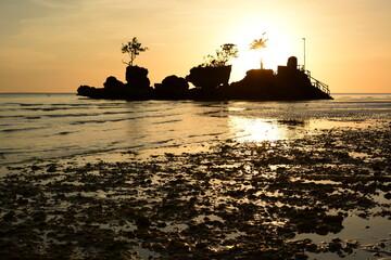 Willy's Rock silhouette at sunset. White beach. Boracay island. Aklan. Western Visayas. Philippines