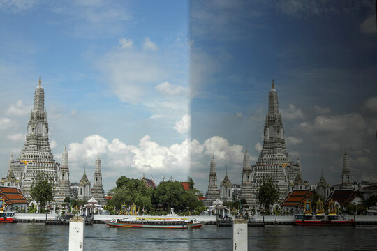 The Wat Arun temple and its reflection in a mirror are seen on the banks of Chao Phraya river in Bangkok