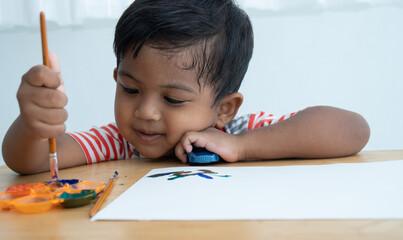 Cute little asian boy paint watercolor