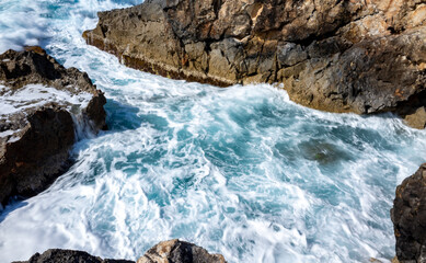 Waves crash on the rocky shore of the Mediterranean Sea on the Akamas Peninsula in the northwest of the island of Cyprus.